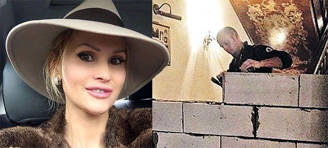 Divorziano e dividono la villa con un muro di mattoni