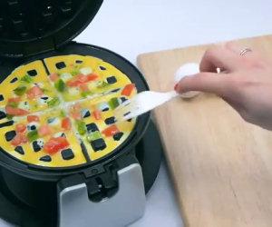 Uova nella piastra per waffle