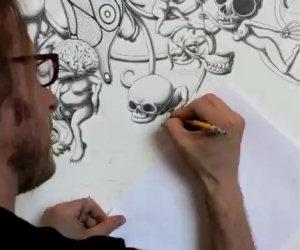 Prende una matita e inizia a disegnare un'opera incredibile sul muro